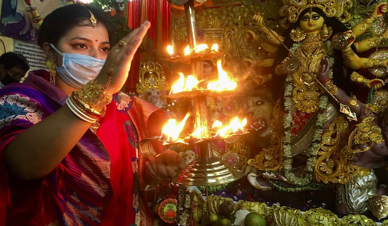 The annual Durga puja festival has now turned into a political pie, of which every party wants to have a share | Salil Bera
