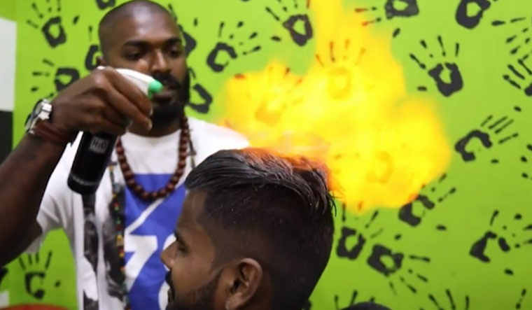 Chennai barber's new hair-cutting technique―set it on fire!