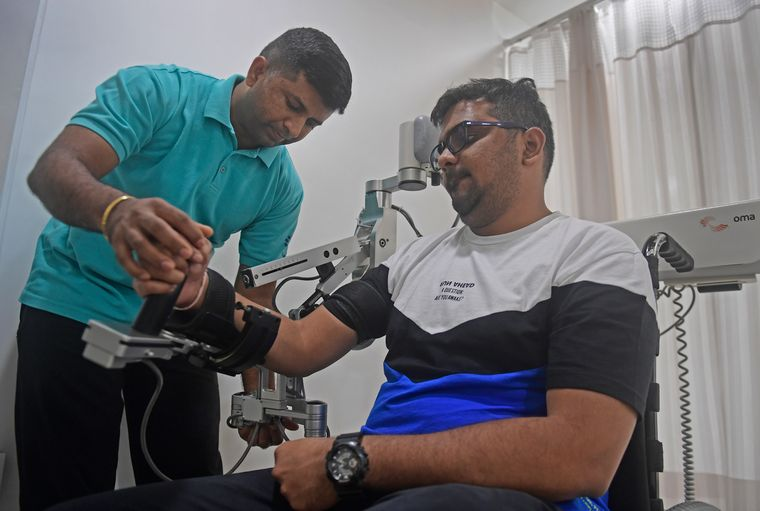 Help at hand: Kuldeep Thakur, who suffered a stroke in 2014, undergoing robotic upper limb training at the Kokilaben Dhirubhai Ambani Hosptial in Mumbai | Amey Mansabdar