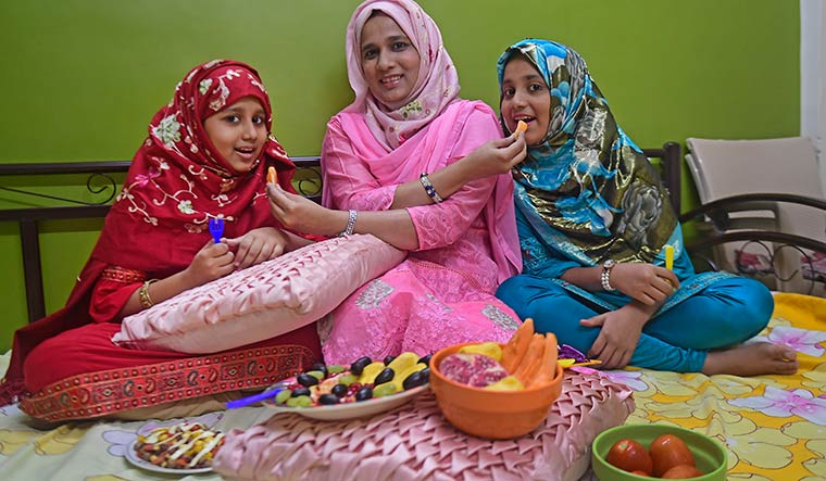 Fruit truths: Nutritionist Munazzah Kazi with her daughters, Zinirah (right) and Zahara | Amey Mansabdar