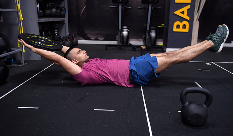 Weight, lift: Rishabh Telang, fitness expert at cure.fit, says doing bodyweight exercises strengthens the core and helps you with consistency   Bhanu Prakash Chandra