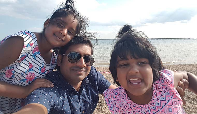 Helping hand: Ramesh Subbiah with his children. He could not take part in the trials as he was busy supporting families of colleagues who had tested positive for Covid-19.