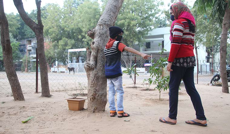 Sibling revelry: Abhijit Solanki plays with his elder sister Namrata outside their home in Gandhinagar | Janak Patel