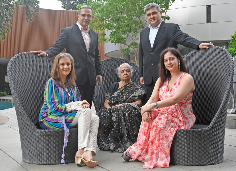 In it together: Ashish and Anish Tripathi with mother Usha, sister Bhavna Roy (left) and Anish's wife Meeta | Amey Mansabdar