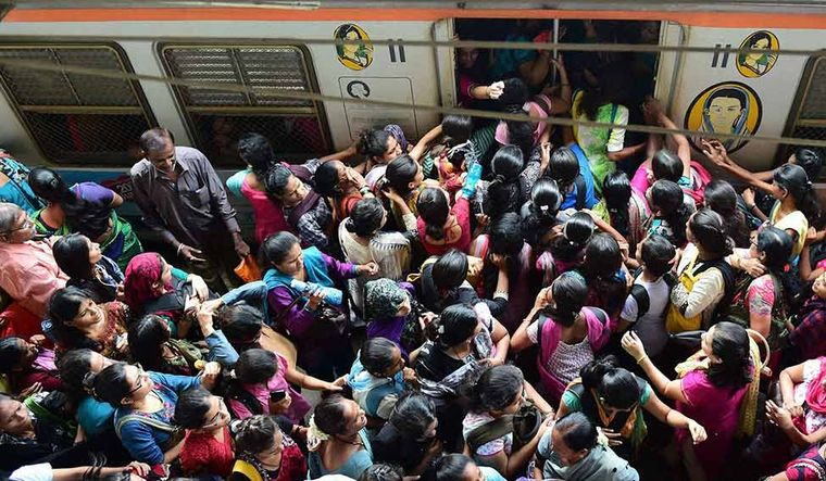 Awaiting Disaster: A daily sight in Mumbai, when passengers are pushed in and out of crowded local trains | PTI