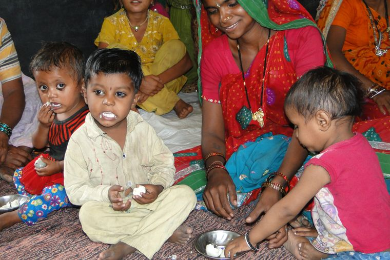 Protein power: Children eat eggs at an anganwadi in Indore as part of a gram panchayat project in 2016.