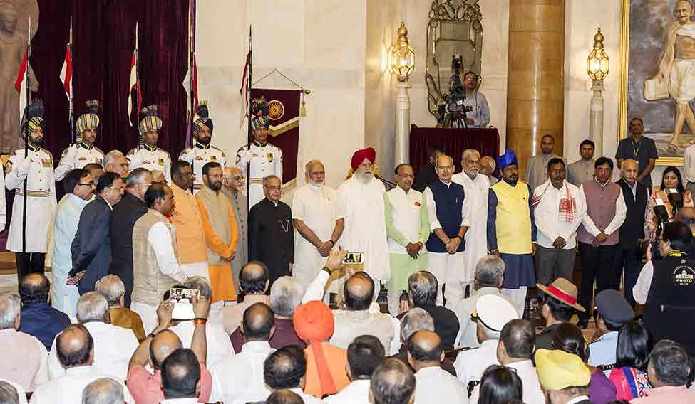 Modi and President Pranab Mukherjee with the newly inducted ministers