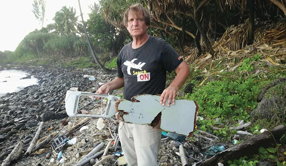 Piecing together the story: Blaine Alan Gibson with pieces of Flight MH370 debris on Riake beach in Madagascar.