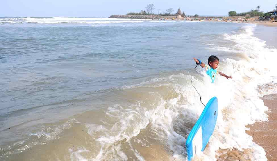 Children in Mahabalipuram are taught surfing at a young age