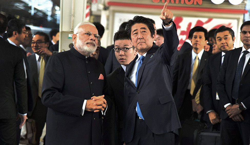 Gaining speed: Modi and Abe before a bullet train trip from Kobe to Tokyo.