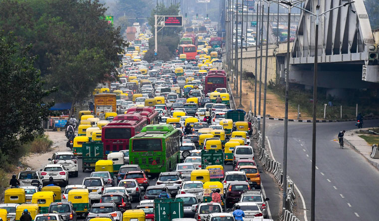 City on hold: Vehicles stuck in a traffic jam in new Delhi. A proposal to earmark dedicated corridor for buses had met with legal challenges | AFP