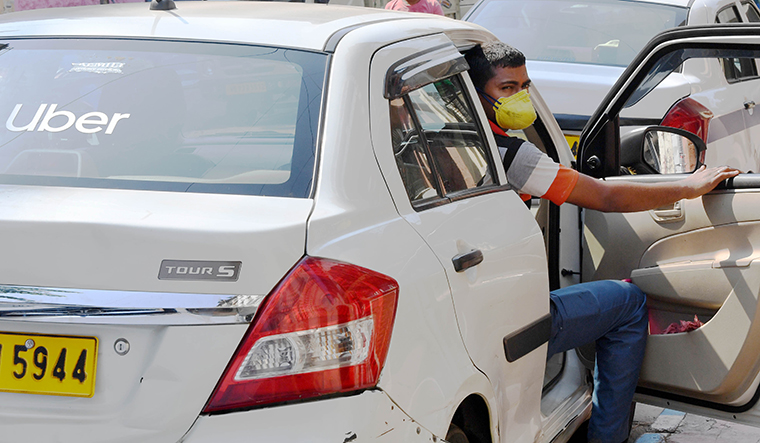 Bhola Saw, a 32-year-old Uber driver-cum-owner worries that he will be unable to pay his EMIs amid no business during the lockdown period | Salil Bera