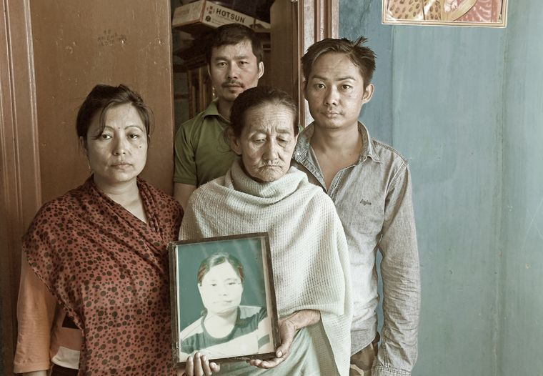 Painful memories: Khumanleima holding Manorama's picture. Flanking her are Manorama's two brothers and sister, Sunita | Salil Bera