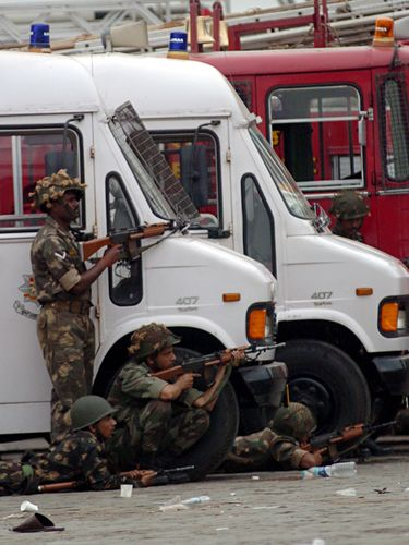 Target zone: Indian Army personnel take position near the Taj hotel during the 26/11 attacks.