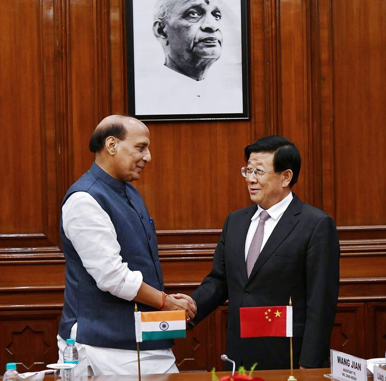 Cold handshake: Rajnath Singh with Zhao Kezhi, China's minister of public security, in Delhi. China has rejected India's demand that Baruah be extradited to India | PTI