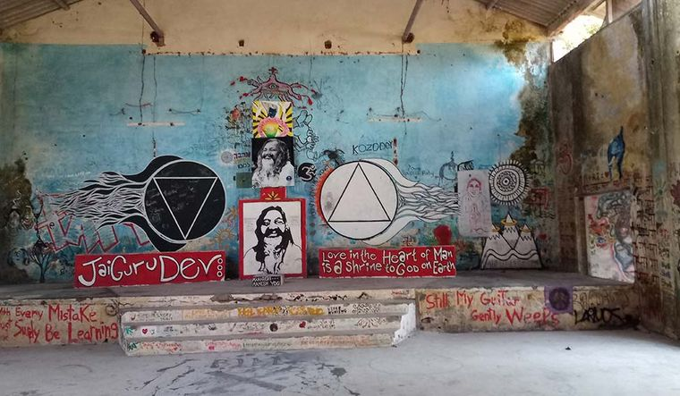 Writing on the wall: Nicknamed The Beatles Cathedral, the ramshackle building in the rundown Maharishi's ashram features graffiti by numerous artists from across the globe | Vaisakh E. Hari
