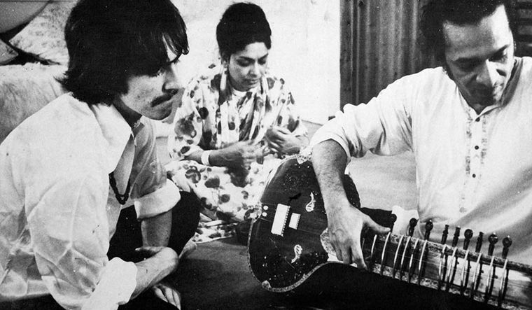 Strings, attached: Legendary sitar player Ravi Shankar with George Harrison. The latter became a disciple of Ravi Shankar to master the Indian instrument | Getty Images