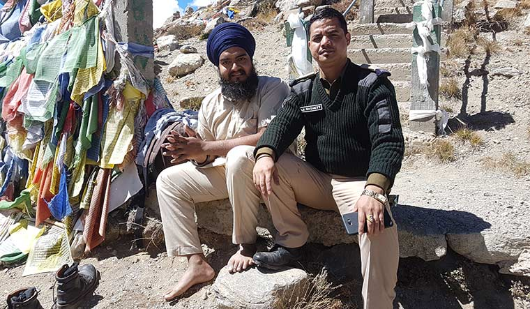 Two is company: Amrit Pal Singh at Gurudongmar lake with an Army jawan who accompanied him.