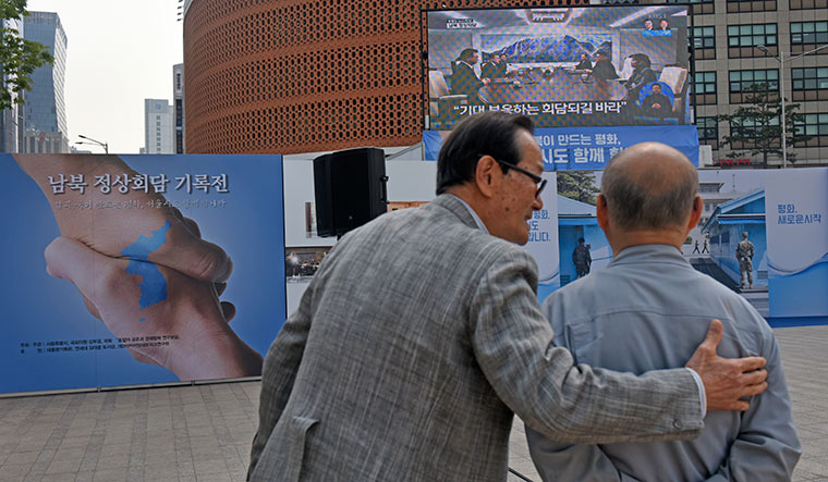 Looking forward: People in Seoul watching the live telecast of the talks | Amey Mansabdar
