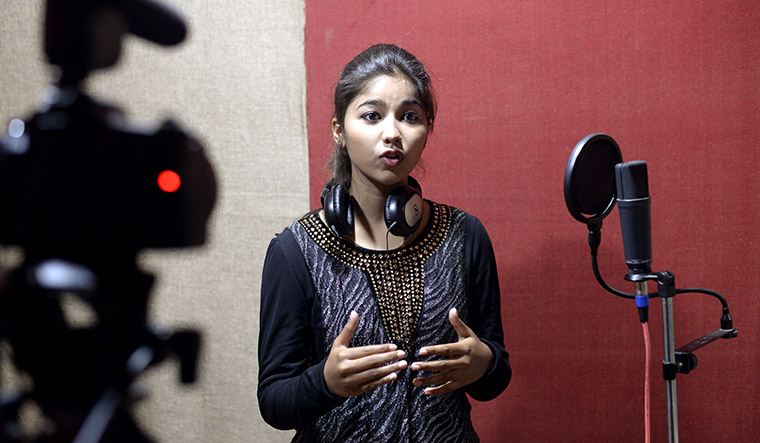 Ginni Mahi, an 18-year-old music student, has become a new pop sensation with her songs dedicated to the soaring confidence of dalits | AFP