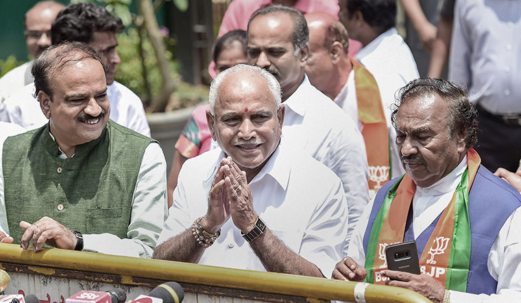 Dramatic return: B.S. Yeddyurappa (centre) of the BJP has been given the first chance by the governor to prove his majority in the assembly | PTI