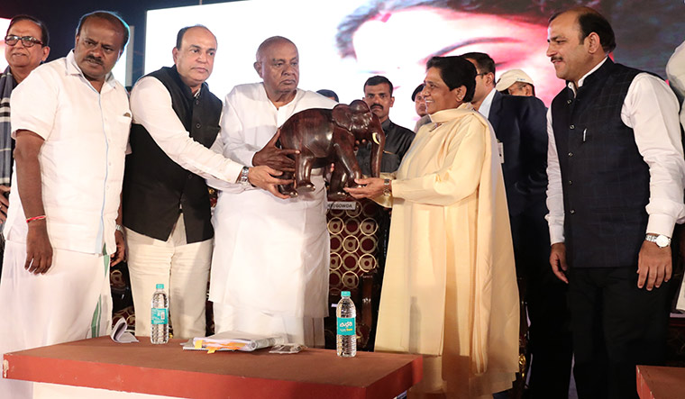 Friends in need: Kumaraswamy and Deve Gowda with Mayawati.