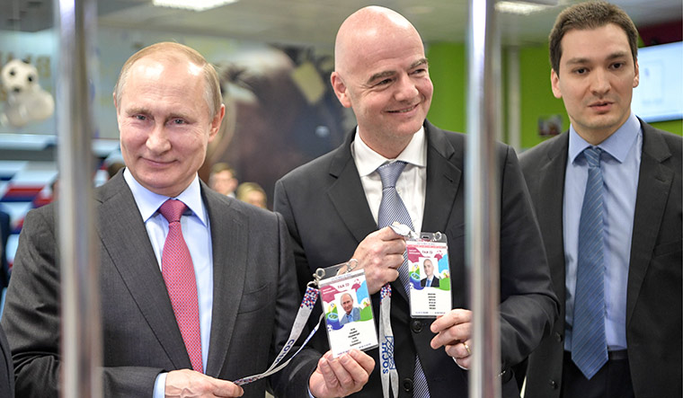 Power play: Russian President Vladimir Putin and FIFA president Gianni Infantino display their Fan IDs in Sochi | Getty Images