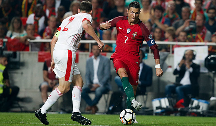 Trick and treat: Portugal's Cristiano Ronaldo in action against Switzerland during a World Cup qualifier | Getty Images