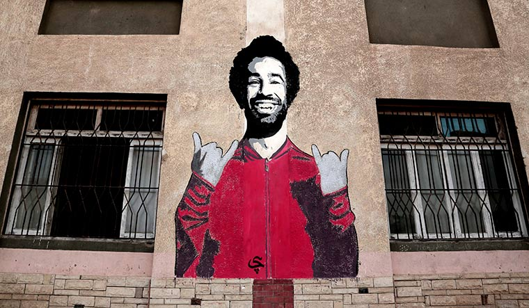 National hero: A mural of Mohamed Salah at a sports centre in Nagrig, Egypt | AP