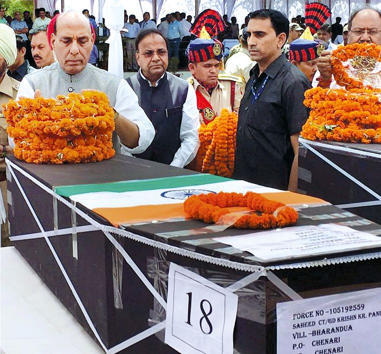 Supreme sacrifice: Rajnath Singh paying last respects to jawans killed in a Maoist attack in Chattisgarh | PTI