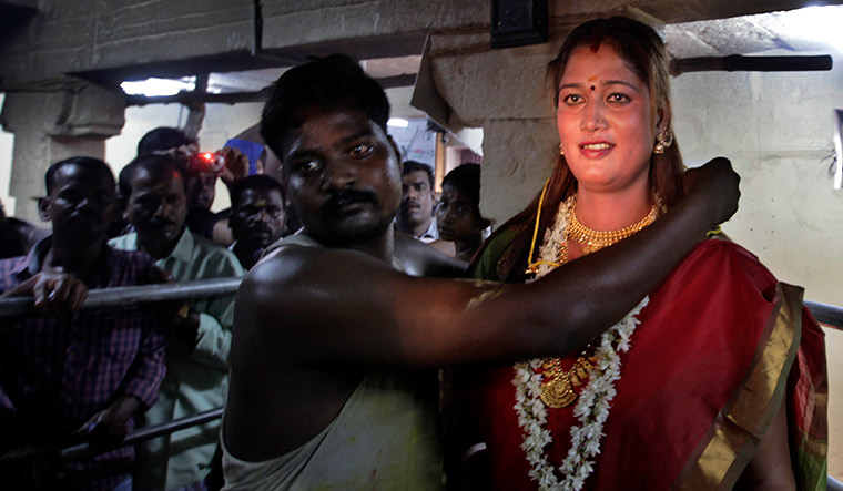 A priest ties a thaali around a transgender woman as part of the ritual | AP