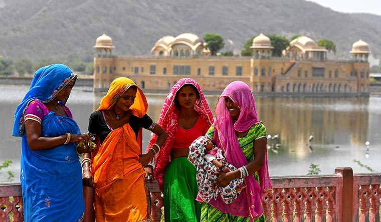 Garb of tradition: A few Rajasthani women in front of Jal Mahal in Jaipur | Salil Bera