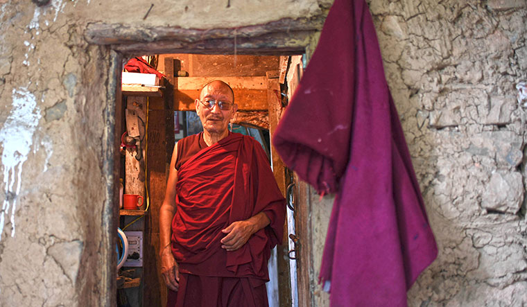 Solitary pleasures: one of the monks of the mud house place who spends his time in solitude | Salil Bera