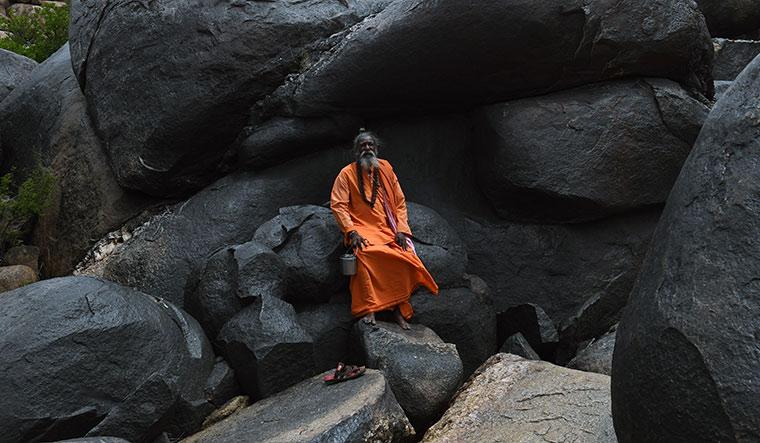 Ramaswamy baba came to Hampi from Koppal in Karnataka 50 years ago and says he enjoys being the last baba of Hampi | Bhanu Prakash Chandra