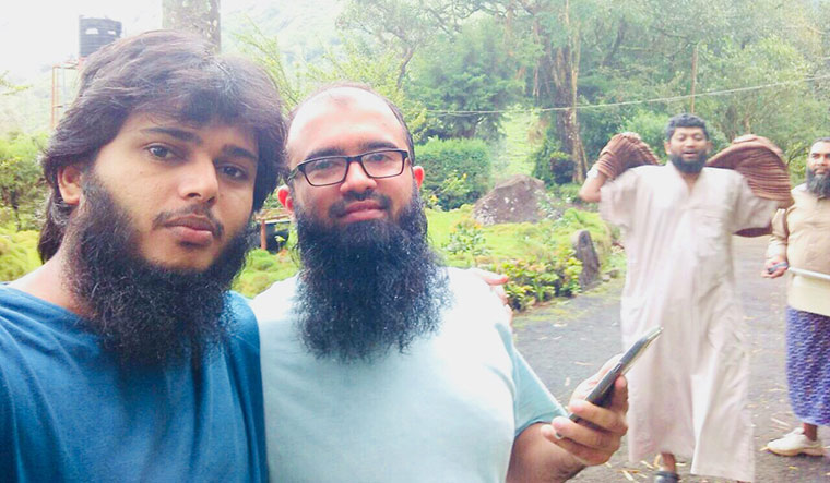 Happier times: Yasar with his best friend, Abdul Rashid Abdullah, before the latter left Kerala to join IS in 2016.