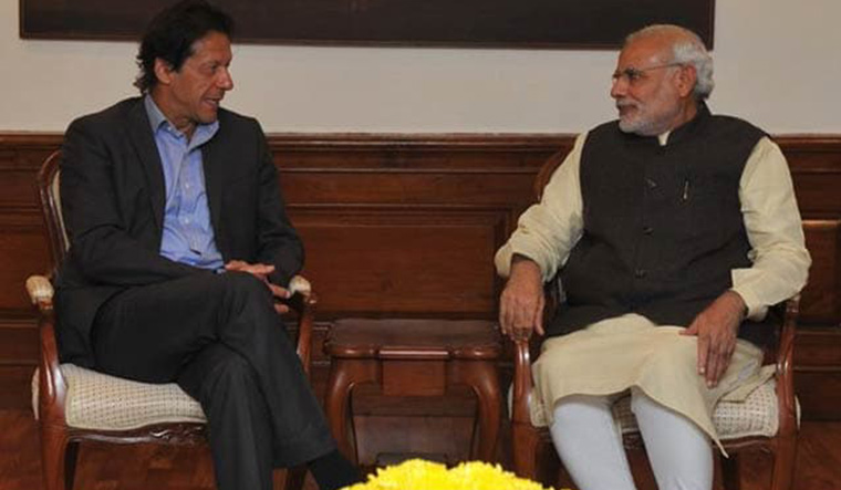 Wary vibes: Imran Khan with Prime Minister Narendra Modi | Twitter, Mea
