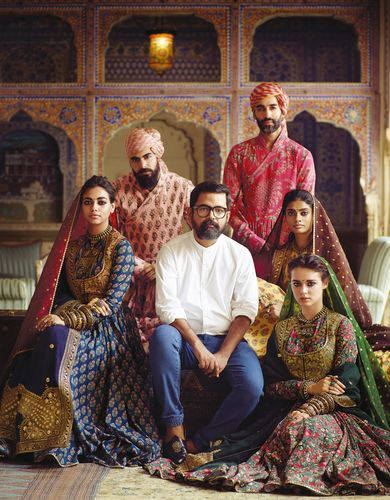 Torchbearer of traditions: Sabyasachi Mukherjee with models sporting his latest creations.