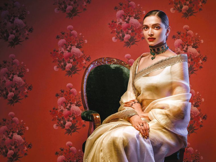 Floral flair: Deepika Padukone in a Sabyasachi sari, with a wallpaper from Nilaya by Asian Paints and Sabyasachi in the background.