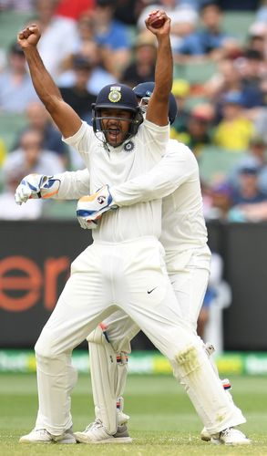 Show time: Mayank Agarwal celebrates after catching out Marcus Harris in the third Test match between Australia and India in Melbourne | Reuters