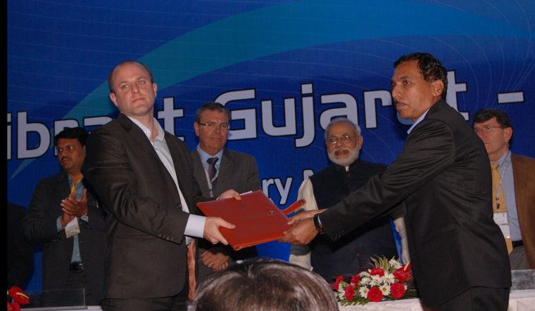 One of J-PAL's first partnerships with a state government in India was with Mr. Modi. This picture shows signing of MoU by John Floretta, JPAL's Director of Policy with Government of Gujarat in Mr. Modi's presence