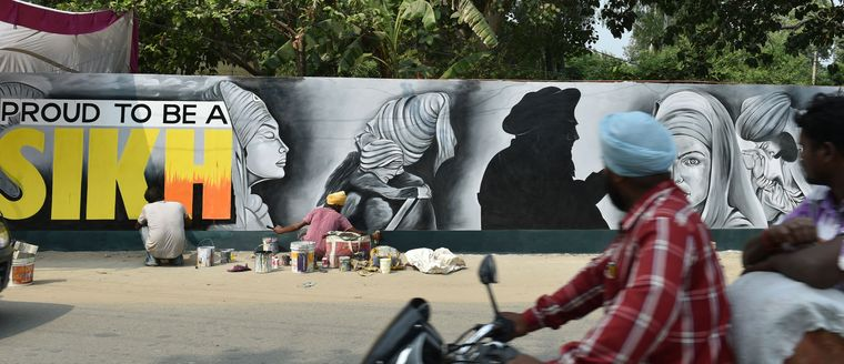 Writing's on the wall: A wall being painted in Sultanpur Lodhi, Punjab | Aayush Goel
