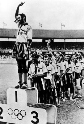 Balbir Singh Sr on the podium at the 1956 Olympics | Getty Images
