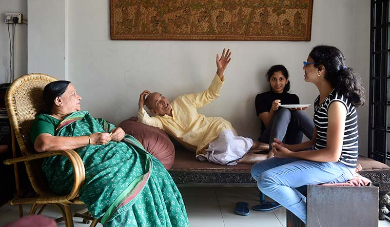 Family time: Gadgil and Sulochana with their granddaughters, Tara and Revati.