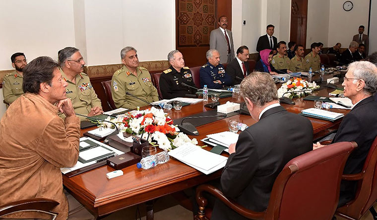 High alert: Prime Minister Imran Khan addresses a meeting of Pakistan's national security committee | AFP