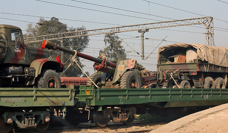 Lethal weapons: a train loaded with army trucks and artillery guns parked at a railway station on the outskirts of jammu | Reuters