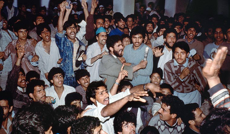 Anger in the air: A discussion among moderate and militant separatists at a mosque in Anantnag in October 1989, following allegations of rigging of the 1987 assembly polls | Getty Images