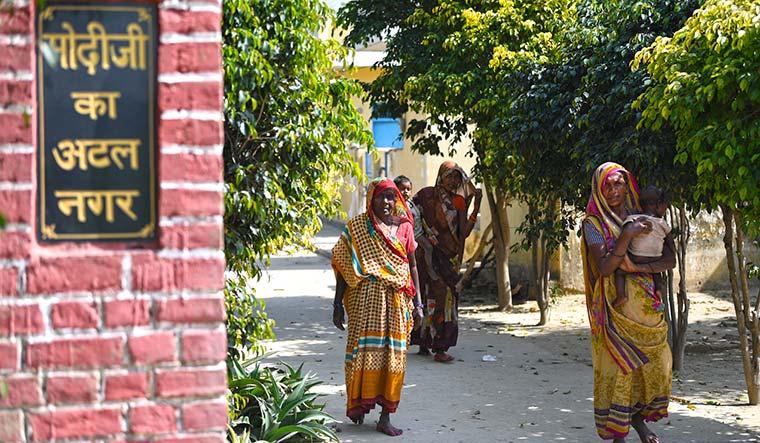 Roof, at last: Women at the entrance to Atal Nagar | Salil Bera