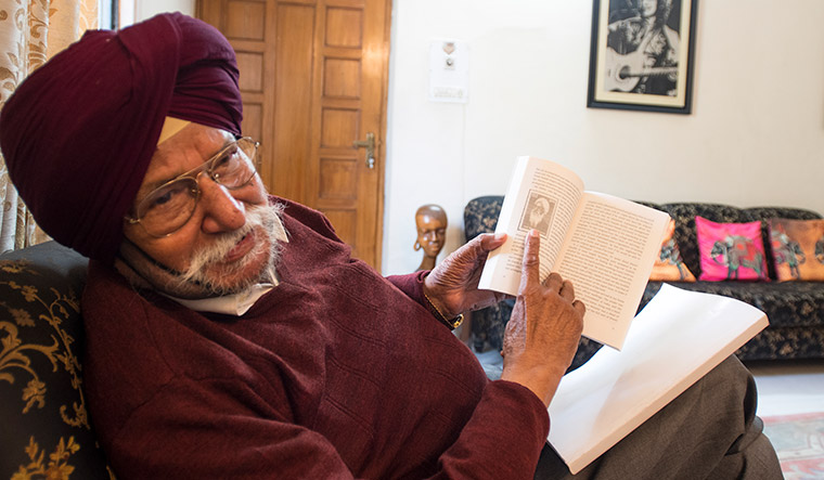 Dark chapter: Kulwant Suri, son of Punjabi writer Nanak Singh, with his father's book, Khooni Vaishaki | Sanjay Ahlawat