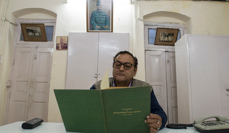 Sukumar Mukherji, caretaker of the Jallianwala Bagh Trust, with the list of martyrs