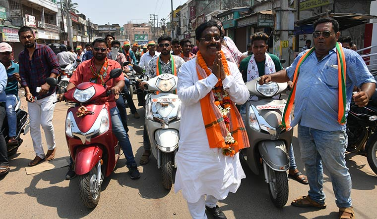 Batting for change: Samir Dey, BJP candidate in Cuttack assembly seat, during a bike rally | Arvind Jain